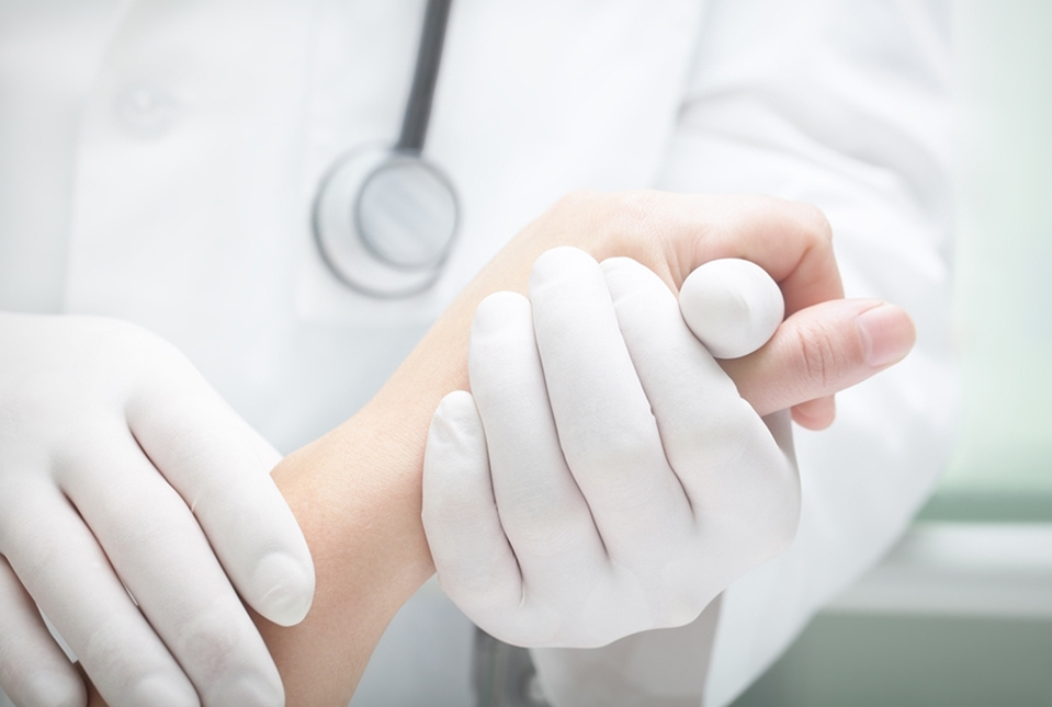 doctor holding patient hand.