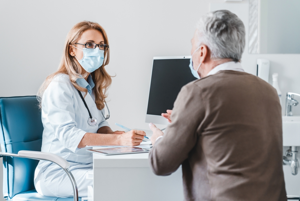 female physician talking to male patient